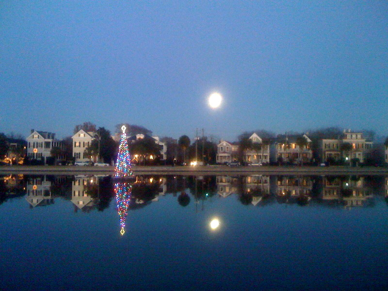 A Full Moon And Christmas Tree At Colonial Lake